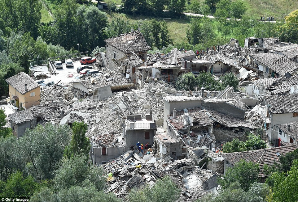 Nothing left: The whole mountainside town of Pescara del Tronto appears to be in ruins and any remaining buildings look close to collapse