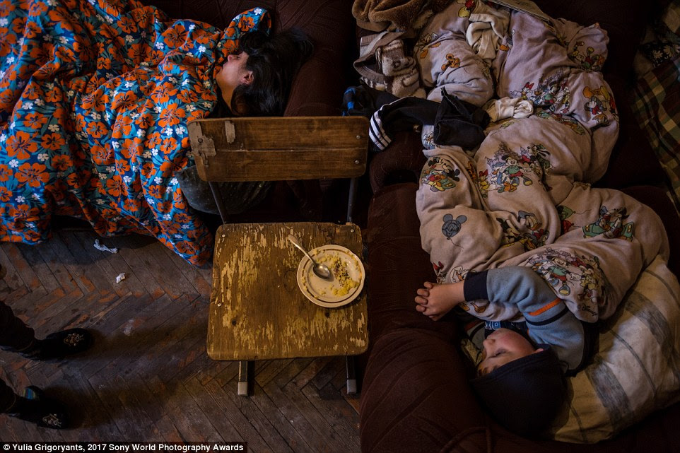 In the poverty-stricken region of Gyumri, Armenia, mum Lusine sleeps with her five children in the only room they have. During the Soviet era, these huge buildings on the outskirts of the city accommodated around 60 families each. Today there are just four families living here, among decaying walls and corridors