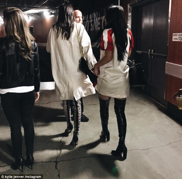 Sweet snap:The star also posted a short of her and Kendall being escorted out the back way of the Staples Center holding hands