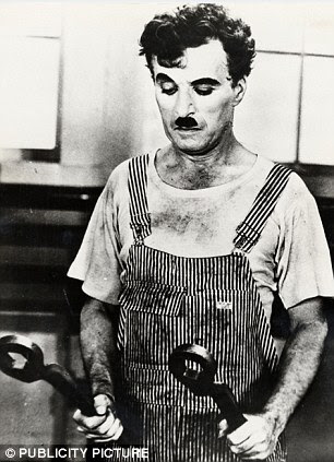 Chaplin pictured in 1936 Modern Times. His wife Lita Grey described him as 'a human sex machine' who could make love six times a night without noticeable fatigue