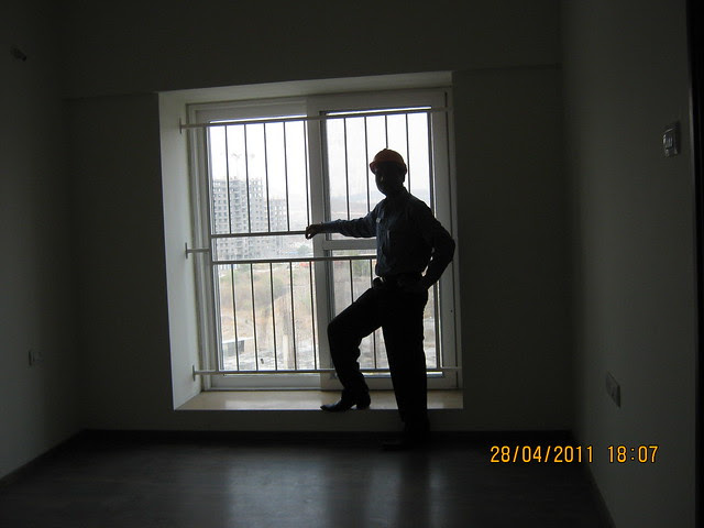 Window in a bedroom of a flat in Sangria Towers at Megapolis Hinjewadi Phase 3, Pune