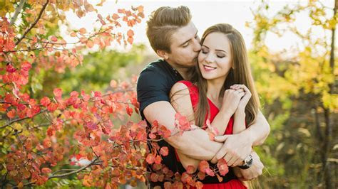 Beautiful loving couple romance in nature autumn leaves HD