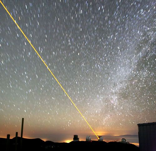 A laser shoots into the sky from one of the Keck telescopes on Mauna Kea.