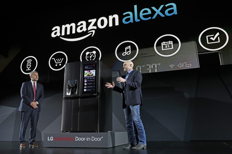 LG Electronics' vice president David VanderWaal and Amazon Echo vice president Mike George present the LG Smart InstaView Door-in-Door Refrigerator to CES 2017 attendees at the LG Electronics press conference. (Jack Dempsey/AP)