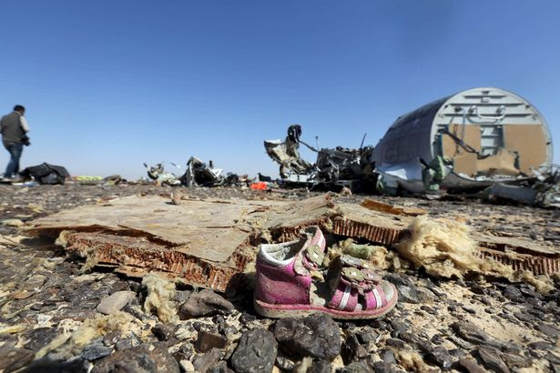 A child's shoe is seen in front of debris from a Russian airliner