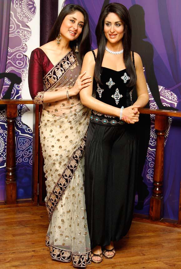 Kareena Kapoor stands with her wax statue