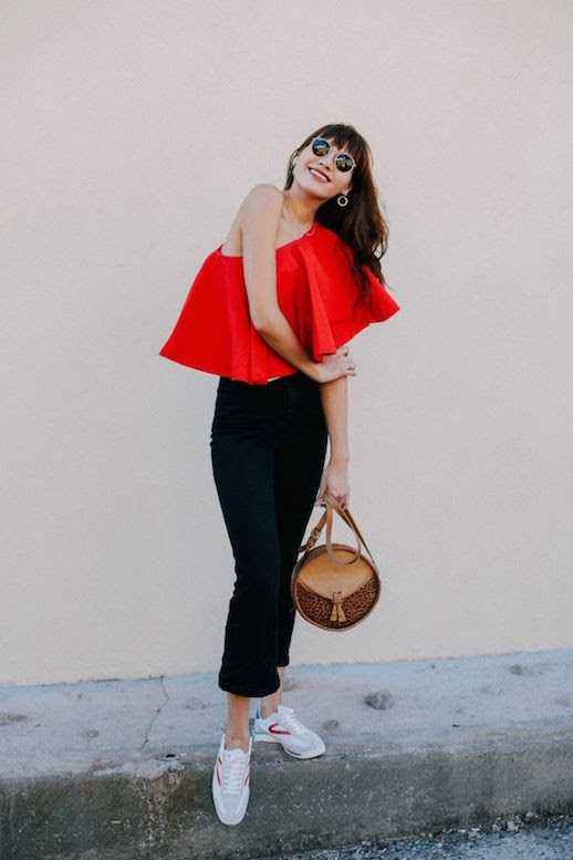 Le Fashion Blog Red Ruffled Blouse Black Pants Sneakers Via Natalie Off Duty