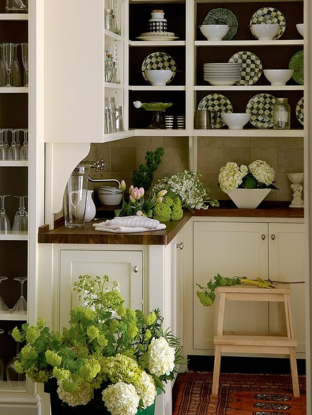 """The walls of the small but open pantry are painted in Farrow & Ball's dramatic """"Mahogany,"""" whose rich chocolate brown is an effective background for highlighting the dinnerware. (photo & design ©Gibbs Smith, Barry Dixon Interiors, Brian D Coleman)"""