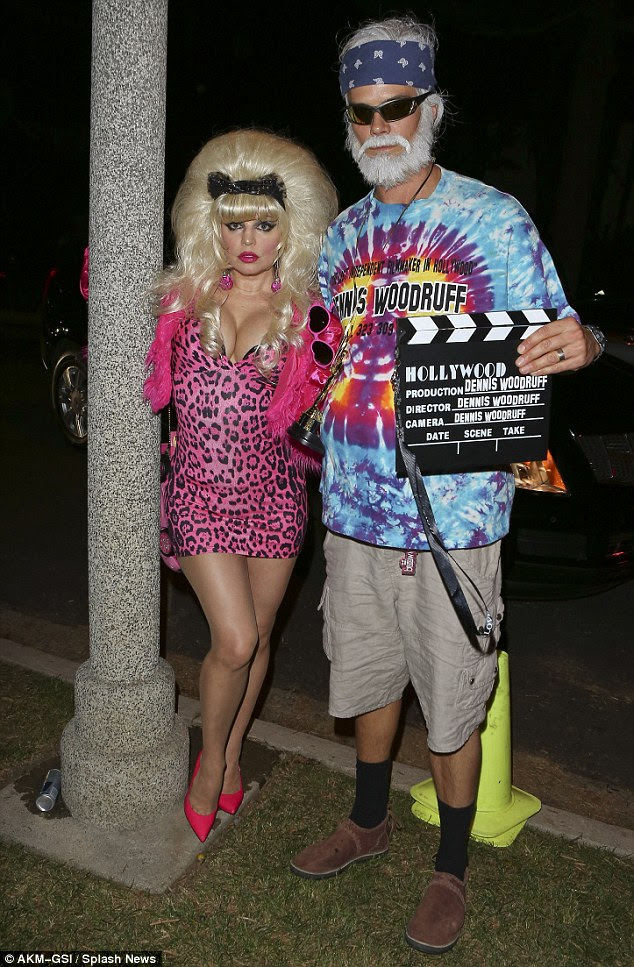 A piece of the action: Fergie and Josh have every detail of their costumes picture perfect