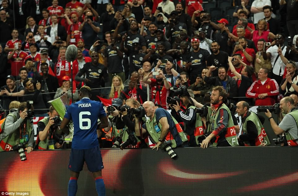 Pogba, not one to shy away from a camera, poses in front of photographers after starring in United's triumph over Ajax