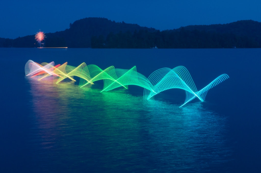 The Motions of Kayaking and Canoeing Recorded through Light Painting on Canadian Waterways water light painting kayaking Canada