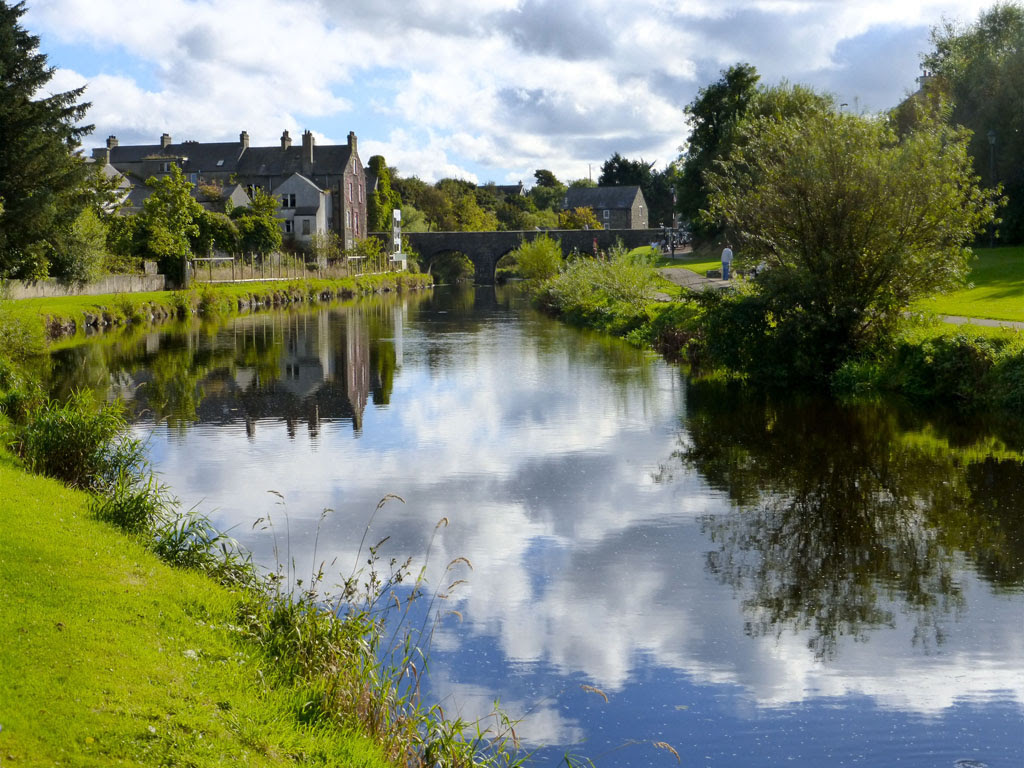 scenic photo of a river and pasture in Bushmills, Ireland