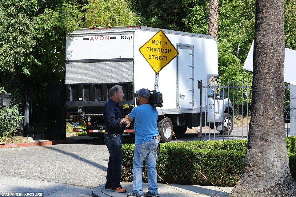 Picking up creature comforts? On Wednesday morning moving vans were seen arriving at the Los Feliz home. It is not known what the vans picked up as the property Angelina has rented is fully furnished