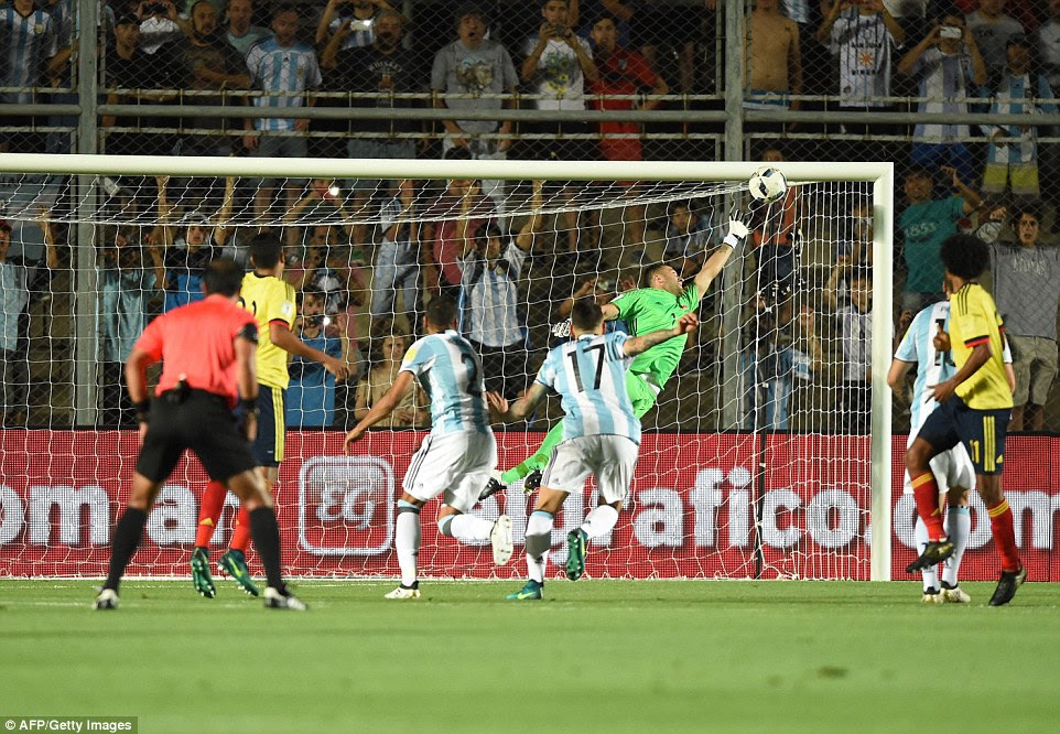 A despairing David Ospina (2nd right) could only watch on as the Argentine's strike flew past him into the goal