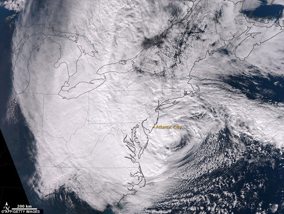 Mammoth storm: This satellite picture released by NASA shows Hurricane Sandy approaching the densely populated US East Coast at 1:35pm EDT on Monday
