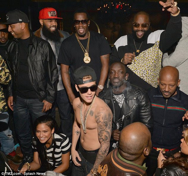 Suspicious: Justin and his rapper pals were surrounded by smoke as they partied at Vanquish nightclub on Wednesday although the star only drank soft drinks all night