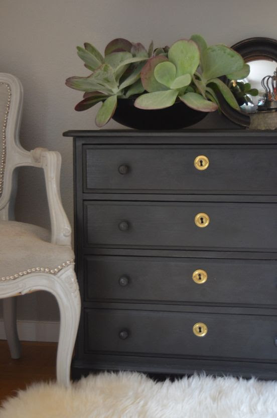 Charcoal with brass keyhole covers is what makes this a stand-out piece