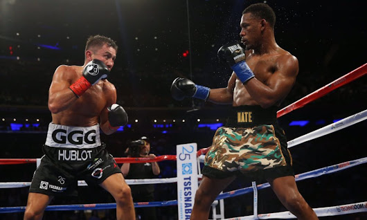 Golovkin edges Jacobs to retain titles