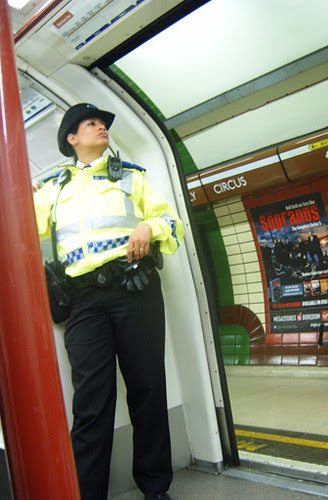 Police Woman on tube at Piccadilly Circus Station