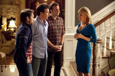 Dale, Nick and Kurt meet Dave Harken's (very) friendly wife Rhonda (Julie Bowen) in HORRIBLE BOSSES.