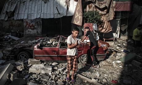 Palestinian children inspect damage from Israeli air strikes in the Gaza Strip.