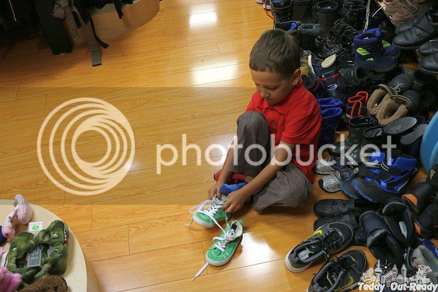 Trying keds at Kid2Kid Store