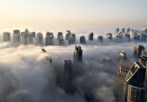 A general view shows the part of the skyline of Dubai covered in an early morning fog on October 5, 2015