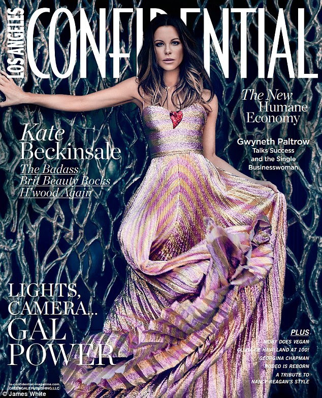 Flawless:The 42-year-old stuns on the cover in a pale pink and yellow gown with tousled waves