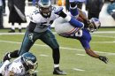 New York Giants' Wilson is tackled by Philadelphia Eagles' Asomugha and Chaney in their NFL football game in East Rutherford