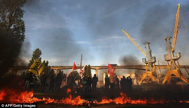 Strikers block fuel storage depots in Caen, northwestern France