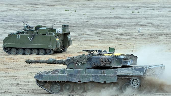 Tanks drive during a NATO Response Force exercise in Zagan, southwest Poland on June 18, 2015