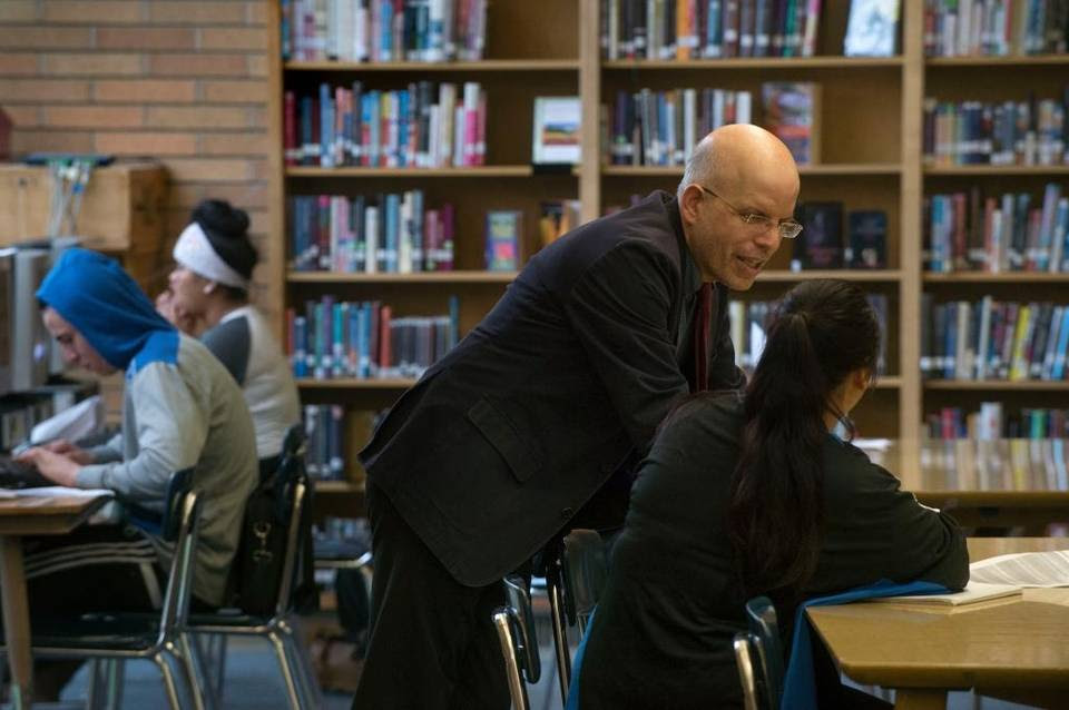 Teacher Larry Ferlazzo works with a student in January at Luther Burbank High School in Sacramento, which pairs student teachers with veteran teachers.