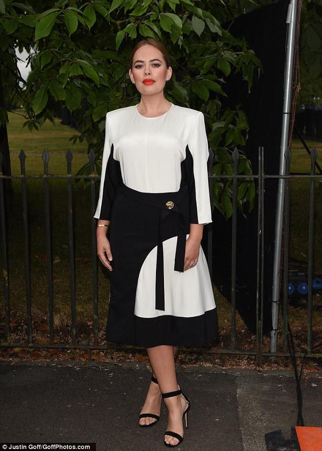 Monochrome maven: Beauty blogger Tanya Burr looked chic in a futuristic black and white midi dress