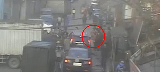 Safe and sound: The girl (circled) was pulled out and taken to hospital, where doctors said she was fine