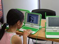 A girl using a $100 laptop at Wikimania Confer...