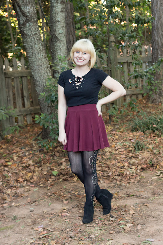 Outfit: Lace Up Top, Skater Skirt, Patterned Tights, and Novelty Pins