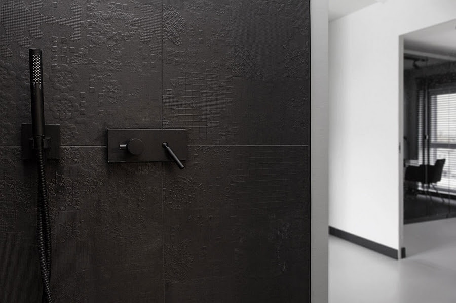 Black tiles with intricate, modern pattern in the contemporary bath