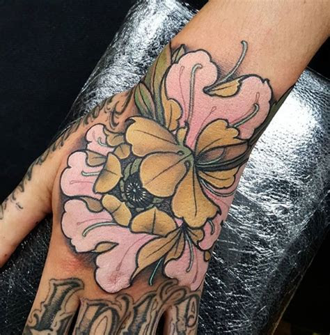 school style colored hand tattoo cute flower