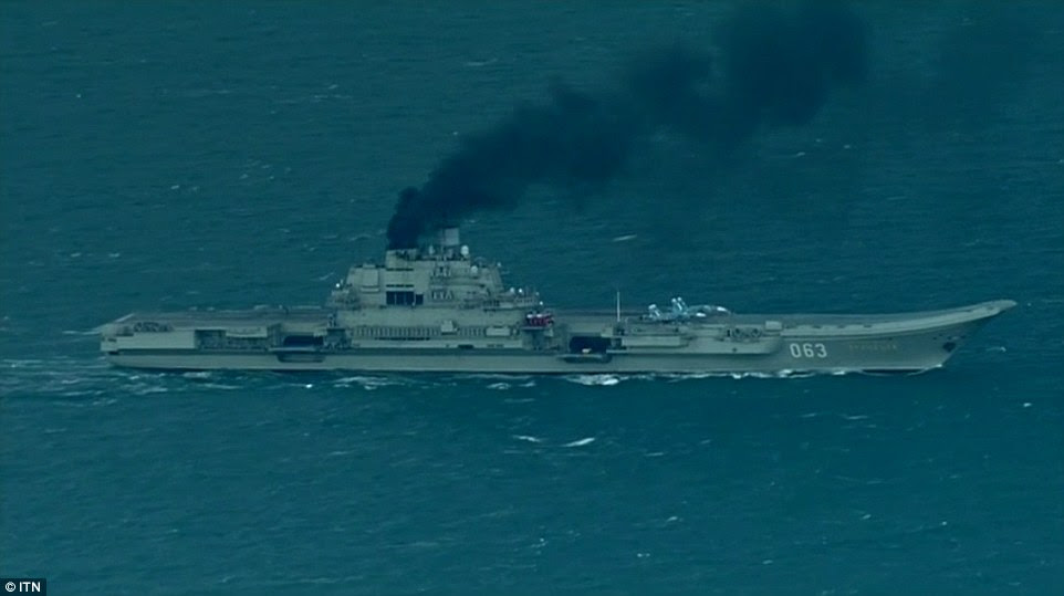 Smoke on the water:  Admiral Kutnesov, pictured here belching toxic fumes as it steamed through the English Channel today
