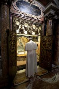 Pope Francis prays in front of tomb of  St. Peter on All Souls' Day