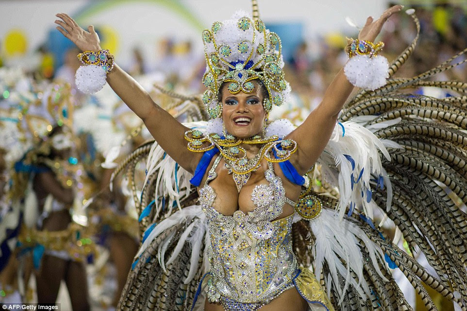 A reveller from Beija Flor samba school makes her way through the Sambadrome to cap the wild festival with a two-day party