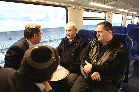 Prime Minister Benjamin Netanyahu on a train to the southern town of Sderot, to inaugurate a new, rocket proof train station. As this picture exhibits, Netanyahu's political foundation relies on right-wingers (like Minister of Transportation Yisrael Katz sitting next to him) and the Orthodox, without being one himself. He must devise maneuvers to keep the right at his side, while supporting the secularist Ashkenazi elite where he really belongs.