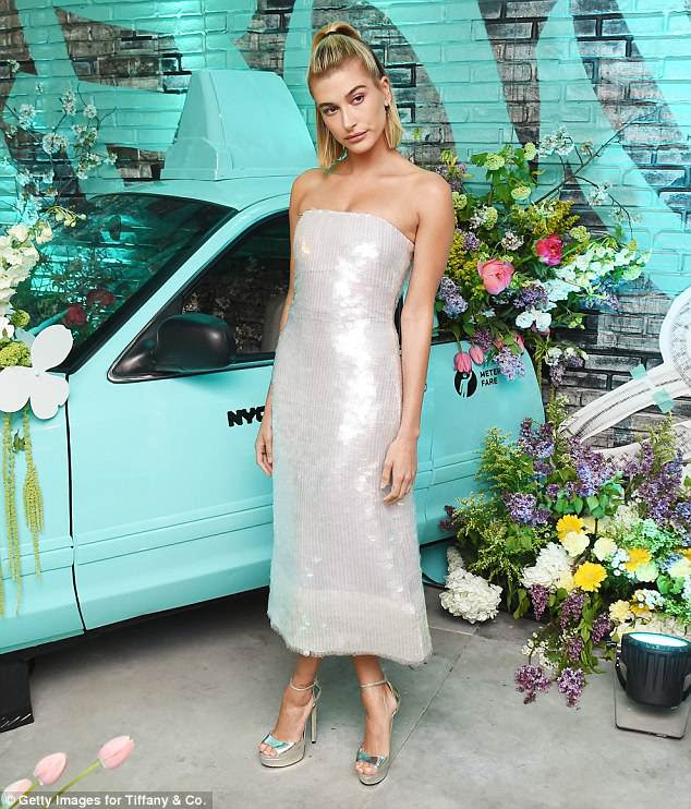 Strapless: 21-year-old Hailey showcased her ample assets in the alluring silver gown as it boasted a strapless design