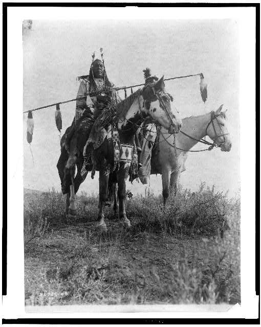 [Village criers on horseback, Bird On the Ground and Forked Iron, Crow Indians, Montana]