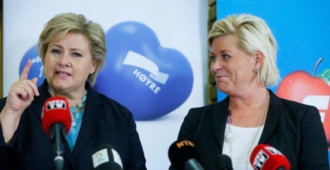 La primera ministra noruega, la conservadora Erna Solberg (izq.), junto a su socia de Gobierno, Siv Jensen, del populista de ultraderecha Partido del Progreso.- REUTERS