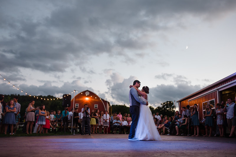 Dancing and reception photos outside at Busy Barns Adventure farms before a wedding at Busy Barns Adventure Farms in Fort Atkinson Wisconsin about 30 minutes east of Madison and an hour north of Chicago. Photo by Mindy Joy Photography.