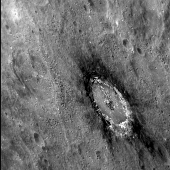 Image Caption This oblique image of Basho shows the distinctive dark halo that encircles the crater. The halo is composed of so-called Low Reflectance Material (LRM), which was excavated from depth when the crater was formed. Basho is also renowned for its bright ray craters, which render the crater easily visible even from very far away. Courtesy NASA/Johns Hopkins University Applied Physics Laboratory/Carnegie Institution of Washington