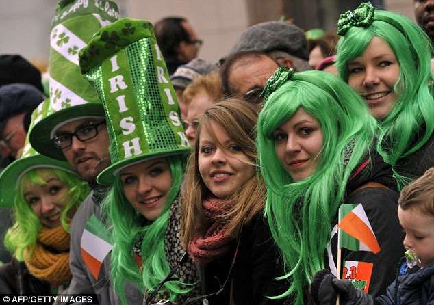 Going green: Thousands turned out to watch the New York City St. Patrick's Day Parade. The longest running in the country