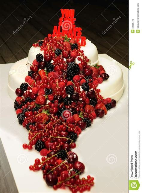 Beautiful Wedding Cake With A Cascade Of Red Fruits Stock