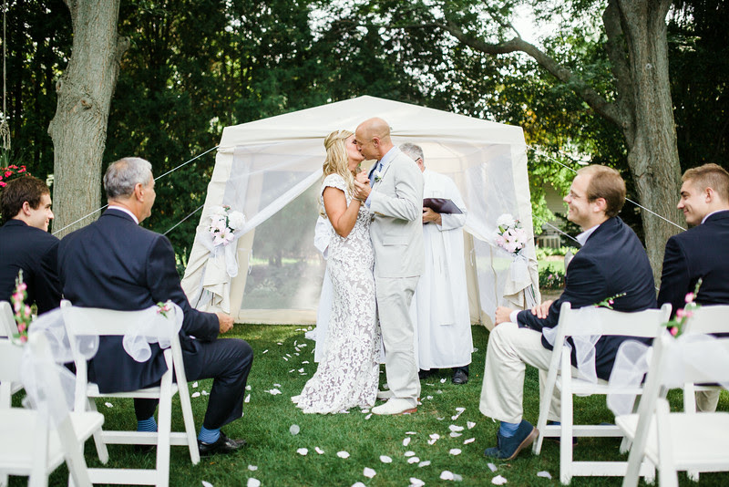 An intimate backyard wedding ceremony in Rockford IL near Sinnissippi with close friends and family.  in Rockford IL with family. Photo by Mindy Joy Photography